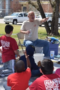 Magician Ron Boyd entertains children at a block party.